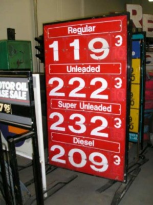 Red, gas prices sign.