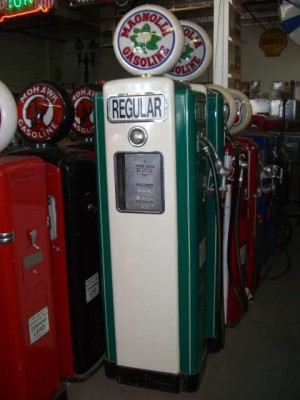 "1940`s Green/White ""Magnolia"" gas pumps."