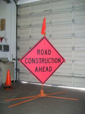 "Mesh, ""Road Construction Ahead"" sign on quad base"
