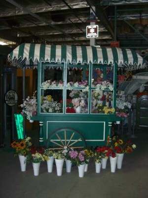 Large Flower Cart w/green and white awning.