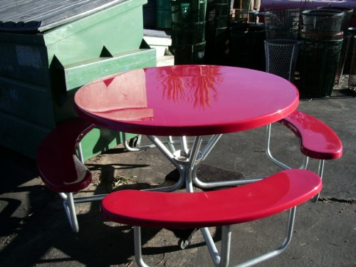 Red fiberglass picnic tables with Attached Benches