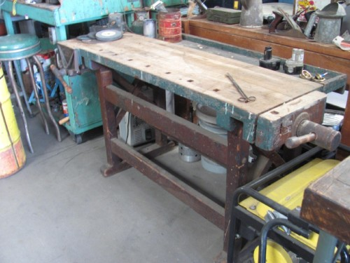 Vintage wood work table with wood vice