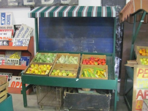Green Wooden Produce Stand with Green Awning